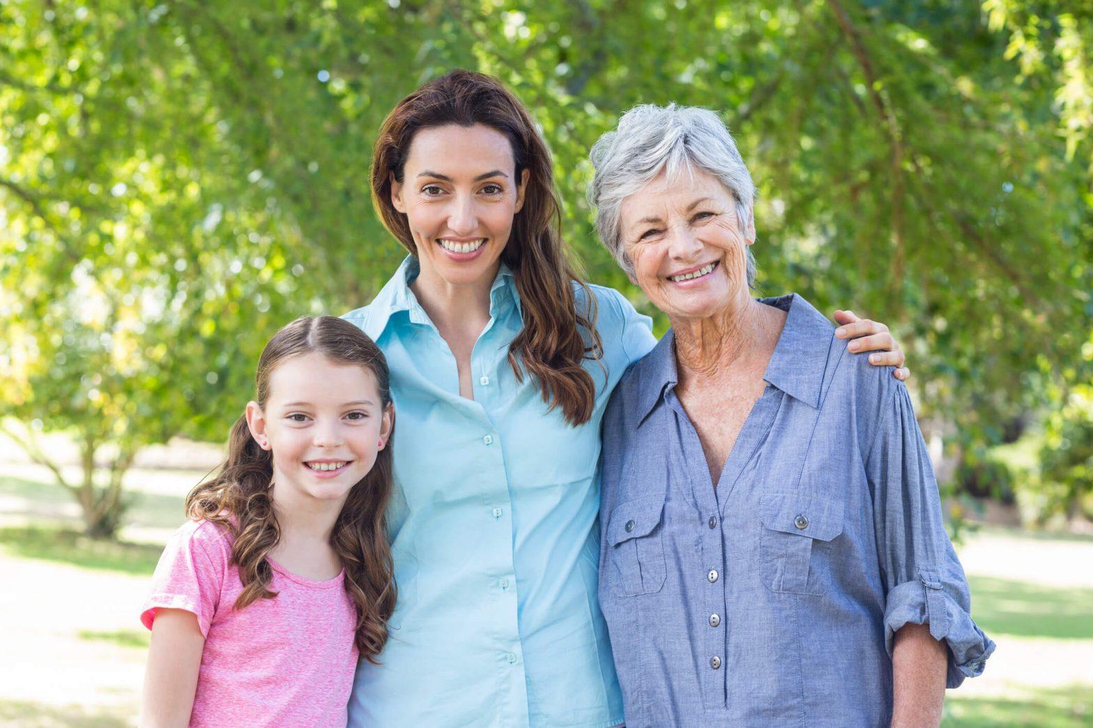 Three women smiling with white teeth